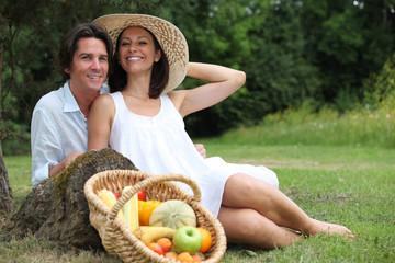 Couple having  vegetarian picnic.