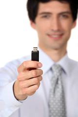 Businessman holding a usb key