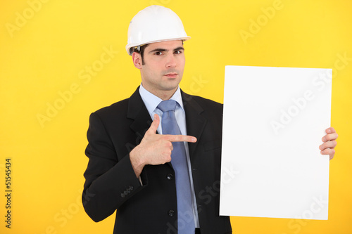 Engineer pointing to a sign
