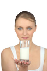 Woman holding a glass of milk