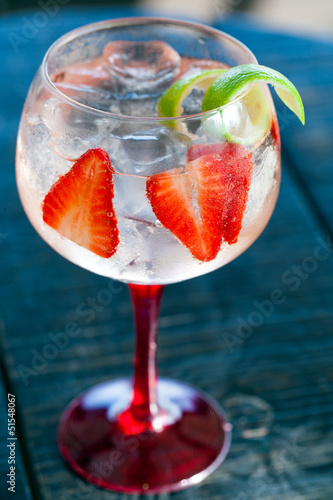 Gin tonic with strawberries.