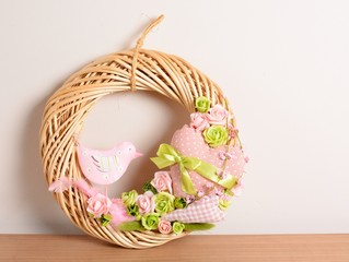Wicker wreath with fabric bird, rose and ribbon.
