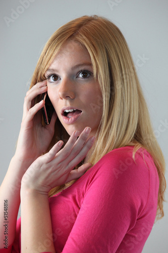 blonde on the phone gossiping with friend