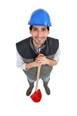 Landscape gardener stood with shovel