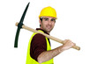 Laborer with pickaxe on his shoulder
