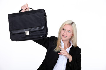 businesswoman holding a brief case