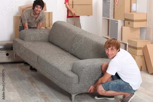 Men lifting sofa