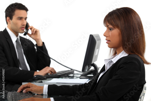 Two businesspeople hard at work