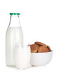 Glass, bottle of milk and cookies bowl