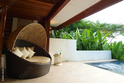 armchair on luxury resort terrace