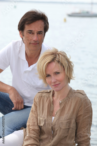 Couple with boat in the background