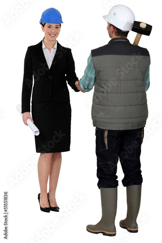 Builder and businesswoman shaking hands