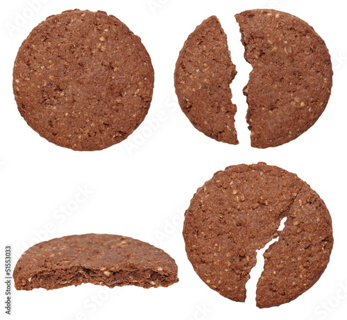 set round wholewheat biscuits with cocoa isolated on white