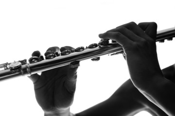 B&W detail of flute keys and hands
