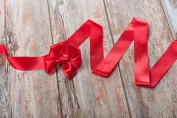 Red ribbon on a wooden table, Horizontal