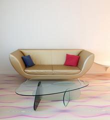 Couch mit Glastisch vor weisser Wand