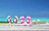 Two pairs of flip-flops against ocean. Exuma, Bahamas