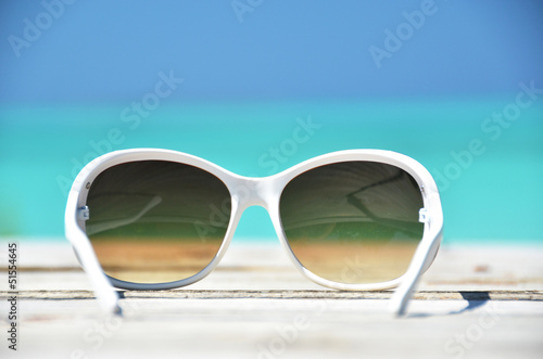 Sunglasses against tropical ocean