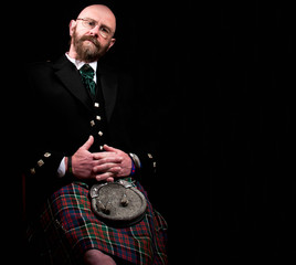 Scottish man wearing a traditional kilt
