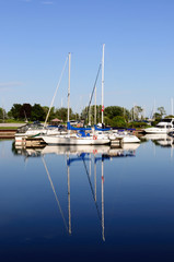 Yachts moored at Marina on a summer day