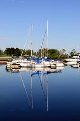 Yachts moored at Marina on a summer day