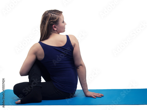 beautiful young woman yoga exercise twist - isolated