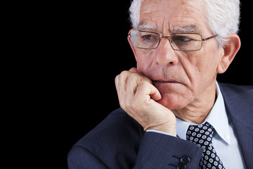 Senior businessman thinking