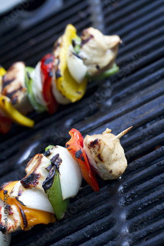 cooked chicken kabob on a grill