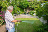 Senior man watering his garden