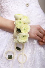 Arrangement. Bouquet of Flowers as Bracelet on Woman's Hands