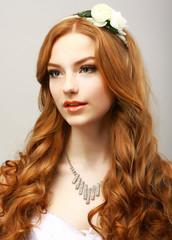 Happy Golden Hair Woman with Flower. Femininity & Sensuality