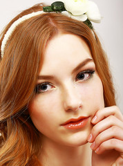 Goodness. Portrait of Young Woman with White Flower on her Head