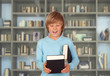 Preteen boy with books for reading