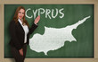 Teacher showing map of cyprus on blackboard