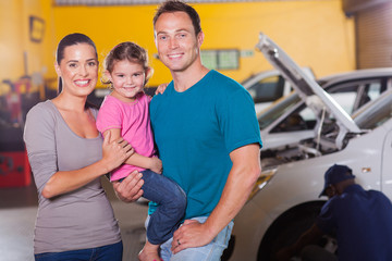 young family waiting in garage