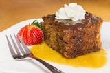 English toffee pudding topped with vanilla whipped cream