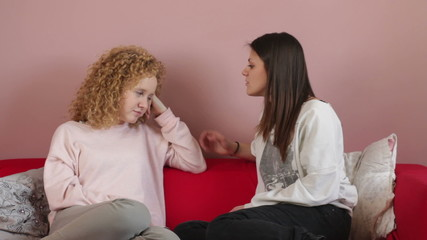 Young woman comforting tearful friend