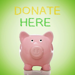 Piggy bank with donate here text
