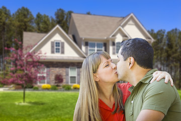 Mixed Race Couple Hugging in Front of House