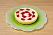 Cheesecake with raspberry syrup © Arena Photo UK