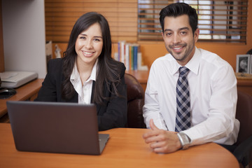 Businessman and woman doing some work together