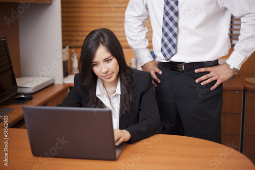 Young businesswoman being sexually harassed at work