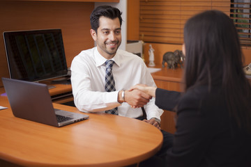 Latin businessman meeting a client in his office