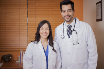 Portrait of a male doctor and a female colleague smiling