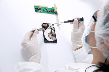 Technical surgeon working on hard drive - data recovery