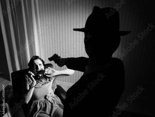 Killer pointing the gun at a terrified woman