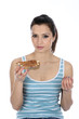Model Released. Woman Eating Buttered Toast