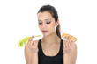 Model Released. Woman Holding Celery and a Sausage Roll