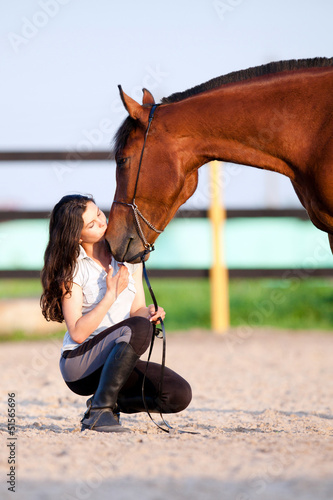 Young girl kiss horse
