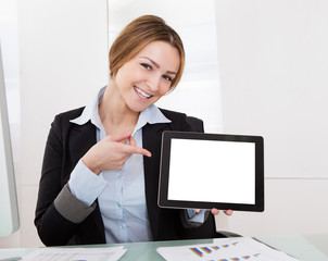 Businesswoman Gesturing On Digital Tablet
